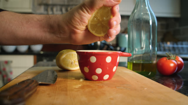 lemon is cut in half and squeezed - citrus fruit stock videos and b-roll footage