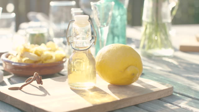 a lemon next to a bottle - next to stock videos & royalty-free footage