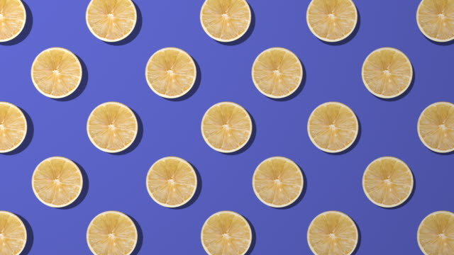 lemon slice spinning pattern on purple background - juicy stock videos & royalty-free footage