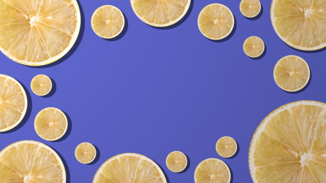 lemon slice with copy space composition on purple background - juicy stock videos & royalty-free footage