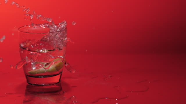 lemon slices fall down in glass with soda,gin,water - slow motion - cachaça stock videos & royalty-free footage