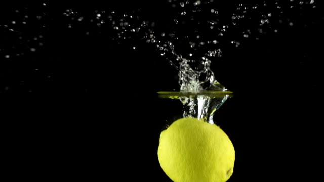 SLOW MOTION: Lemon Splashing