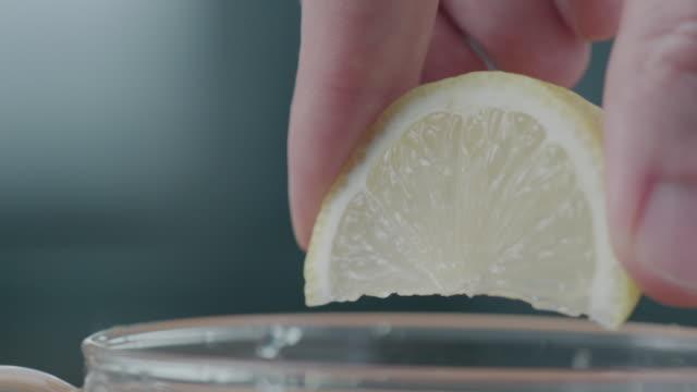 lemon squeeze - fruit juice stock videos & royalty-free footage