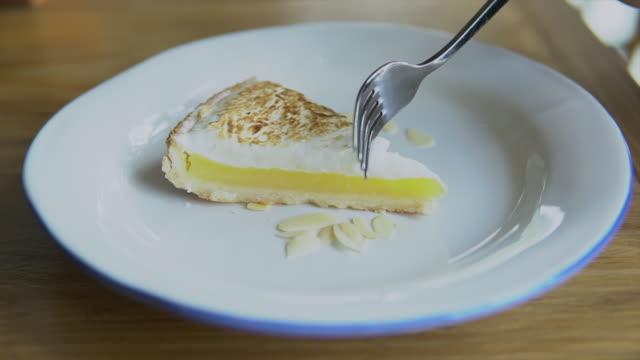 lemon tart dessert in cafe - cutlery stock videos & royalty-free footage