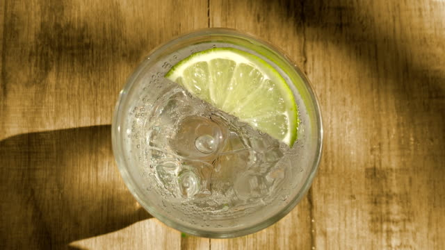 lemon water with ice top view - lemon stock videos & royalty-free footage
