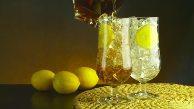 Lemonade and iced tea pour.