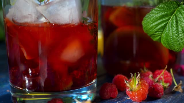 Lemonade with raspberry, peach and thyme
