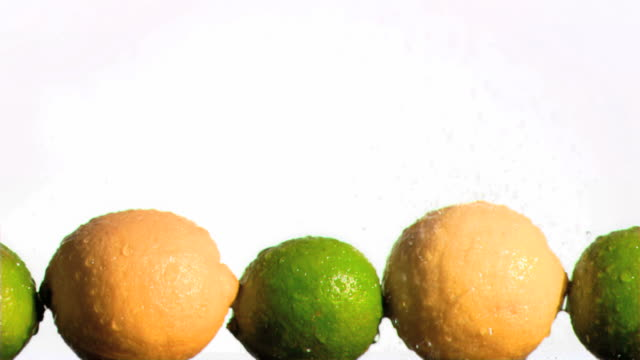 lemons and limes in super slow motion being wet - fünf gegenstände stock-videos und b-roll-filmmaterial