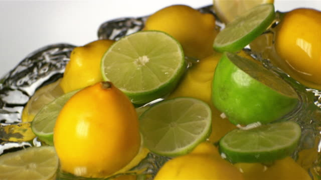 ECU SLO MO lemons and limes in water