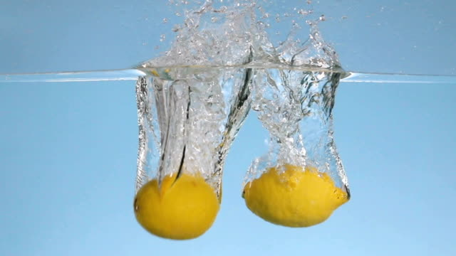 lemons splashing into water - lemon stock videos & royalty-free footage
