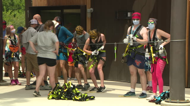 lemont, il. u.s. - people fastening safety harness at zip line at the forge, north america's largest outdoor adventure park on saturday, july 18,... - safety harness stock videos & royalty-free footage