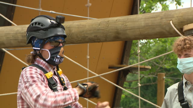 wgn lemont il us people wearing helmets and face masks on jungle gym at the forge north america's largest outdoor adventure park on saturday july 18... - canoeing and kayaking stock videos & royalty-free footage