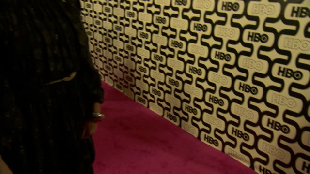 Lena Dunham and Adam Driver laughing hugging posing for paparazzi on the red carpet at Circa 55 restaurant
