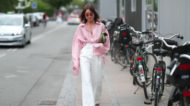 lena lademann wearing pink blouse, high waisted white pants during the copenhagen fashion week spring/summer 2019 on august 8, 2018 in copenhagen,... - ブラウス点の映像素材/bロール