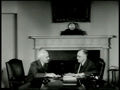 lendlease aid to allies edward stettinius president roosevelt sitting at desk looking over papers cu int booklet for lendlease program cu president... - 1943 stock videos & royalty-free footage