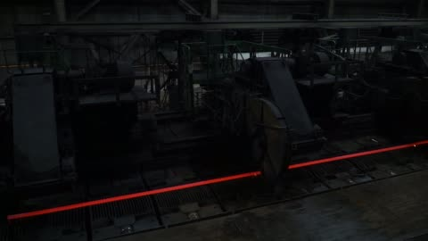 length of glowing steel passes through a large cutting machine at the dneprovsky iron & steel works, operated by evraz group, in dnipro, ukraine, on... - length stock videos & royalty-free footage
