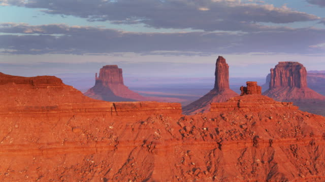 lengthening shadows in monument valley at sunset - drone shot - navajo reservation stock videos and b-roll footage