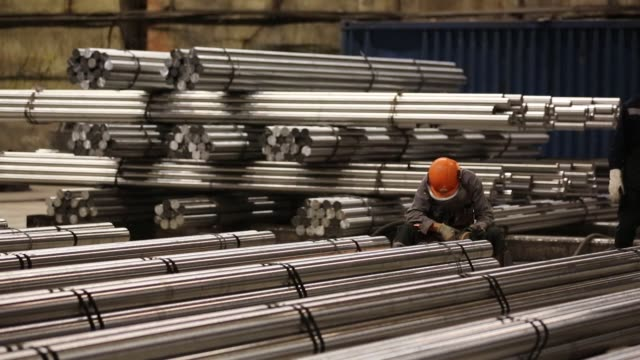 Lengths of rolled steel rods sit in storage ahead of distribution at the Oskol Elektrometallurgical Plant steel mill operated by Metalloinvest...