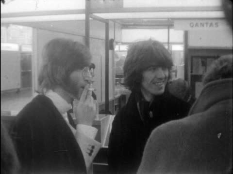 vídeos de stock, filmes e b-roll de lennon with sideburns and specs pan to his wife p boyd as was cms george and john talk cms george lr followed by two wives india rishikesh ts town of... - rishikesh