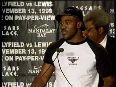 lennox lewis and evander holyfield prepare for fight usa las vegas lennox lewis along to podium during press conference ms evander holyfield along to... - boxing heavyweight stock videos & royalty-free footage