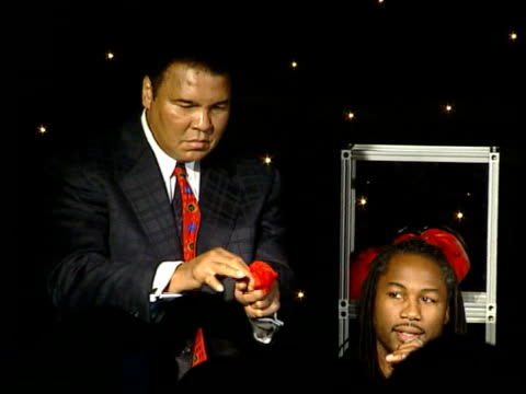 lennox lewis meets muhammed ali ms muhammad ali standing on stage beside lennox lewis as performing magic trick with handkerchief muhammad ali... - magic trick stock videos & royalty-free footage
