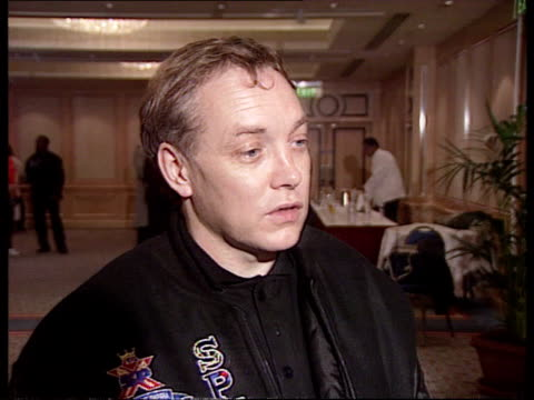 lennox lewis victory cms intvw frank maloney sof on chance of world championship fight lewis throws punch at camera - world championship stock videos and b-roll footage