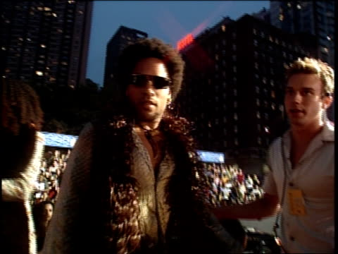 Lenny Kravitz is attending the 1999 MTV Video Music Awards He is saying hello to the camera