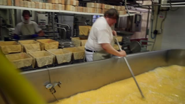 Lenny Zimmel stirs and checks the temperature in a vat of Colby cheese at Widmer's Cheese Cellars on June 27 2016 in Theresa Wisconsin Record dairy...