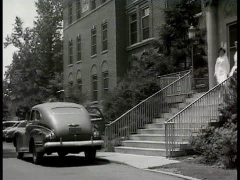 lenox hill hospital w/ many steps to porch late model sedan pulling up to steps two nurses walking down steps 'mr conrad' walking w/ wife 'mrs... - 1948 stock-videos und b-roll-filmmaterial