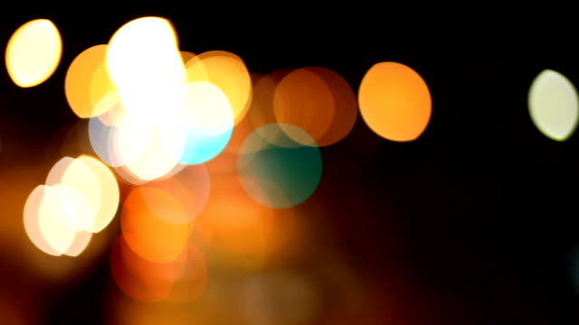 lens blur city and traffic lights - ethereal stock videos and b-roll footage