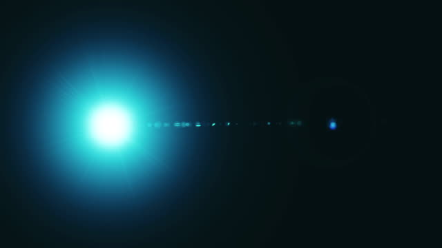 vídeos de stock e filmes b-roll de lens flare, bokeh, lights. - iluminado por holofote