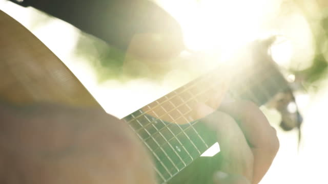 lens flare guitar - guitar stock videos & royalty-free footage