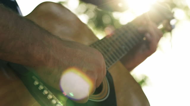 lens flare guitar - fretboard stock videos and b-roll footage