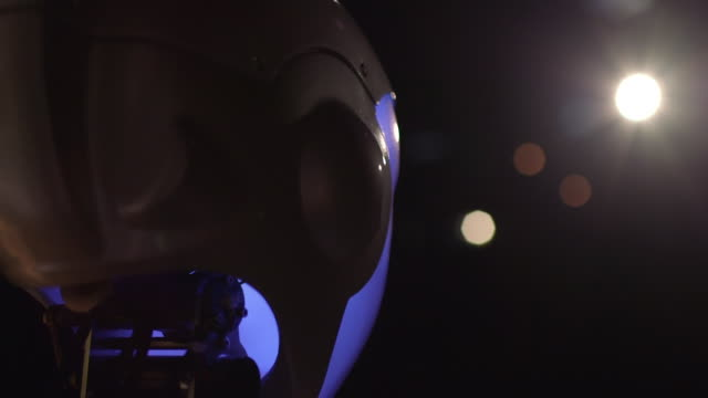 lens flare is created when panning off and onto the head of a humanoid robothespian robot actor looking out into stage lighting during rehearsals for... - actor stock videos & royalty-free footage