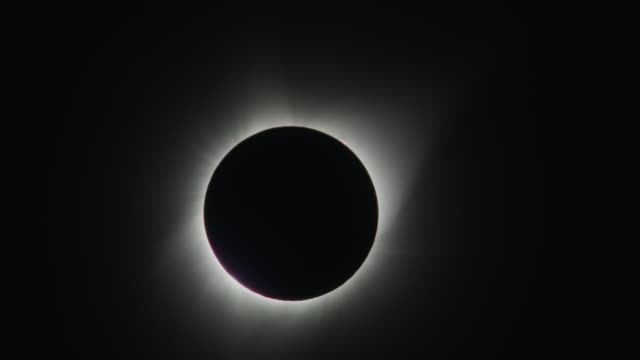 Lens flare on eclipse changing to total solar eclipse / Driggs, Idaho, United States