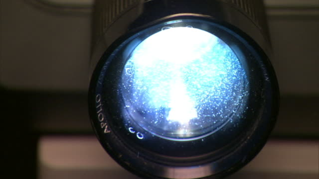 cu lens on slide projector as slides are being shown/ los angeles, california - projektion stock-videos und b-roll-filmmaterial