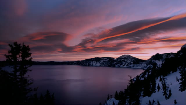 lenticular clouds at sunrise over crater lake - crater lake oregon stock videos & royalty-free footage