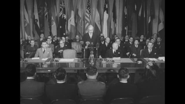 leo s. rowe, director general of the pan american union, stands at lectern during his speech as vo translator speaks in spanish / sot rowe / note:... - incomplete stock videos & royalty-free footage