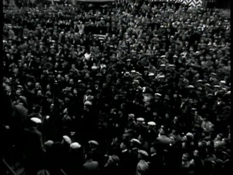 leon degrelle shouting behind podium hand gestures. crowd watching. tank driving through house debris. german panzer tank driving down hill. bomber... - belgium stock videos & royalty-free footage