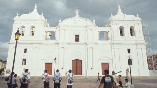 Leon Nicaragua cathedral with restored front building. Ruben Dario Anniversary. Establishing shot for national elections. Nowadays the president is Daniel Ortega of Sandinist national liberation front. B-roll about Zika virus in Central America.