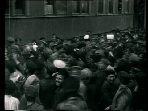 1925 montage b/w ms leon trotsky addressing crowd from train carriage/ ms crowd catching leaflets being thrown from train/ russia - propaganda stock-videos und b-roll-filmmaterial