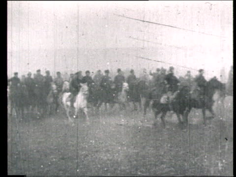 1920 MONTAGE B/W MS Leon Trotsky saluting Red Army cavalry parade/ WS Cavalry riding past on horseback/ Russia