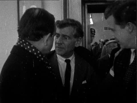 leonard bernstein at lap england the conductor of the new york philharmonic orchestra arrives with the orchestra to give concerts in london and... - conductor stock videos and b-roll footage