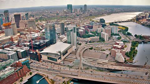 leonard p. zakim bunker hill memorial bridge. boston financial district. charles river. aerial view. - boston massachusetts stock videos & royalty-free footage