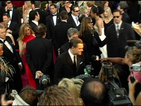 leonardo dicaprio at the 2005 annual academy awards arrivals at the kodak theatre in hollywood, california on february 28, 2005. - 77th annual academy awards stock videos & royalty-free footage