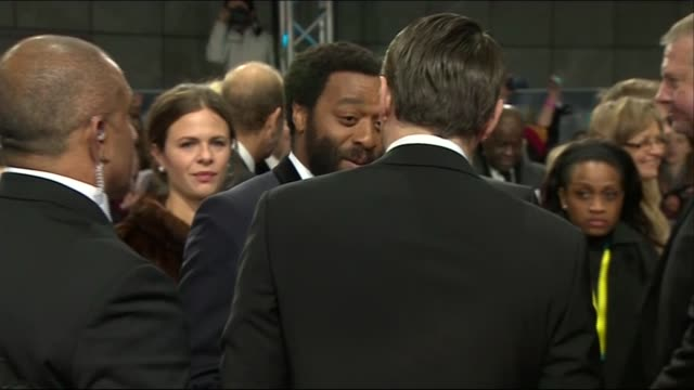 leonardo dicaprio chiwetel ejiofor and harvey weinstein greet on the red carpet of the baftas 2014 - 2014 stock videos & royalty-free footage