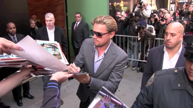 leonardo dicaprio signs autographs for fans as he arrives at 'good morning america' in new york 11/07/11 - leonardo dicaprio stock videos & royalty-free footage