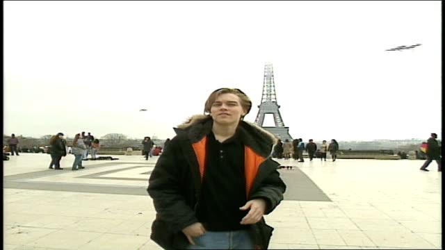 leonardo dicaprio walking around plaza of the palais de chaillot - 1995 stock videos & royalty-free footage