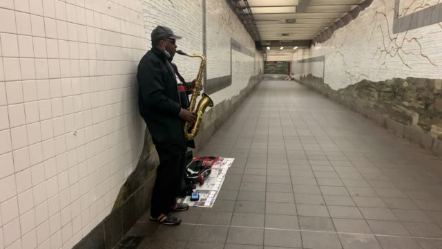 leonardo love plays the saxophone in a new york city subway tunnel during the coronavirus outbreak on april 13 2020 in new york city ridership on... - saxophone stock videos & royalty-free footage