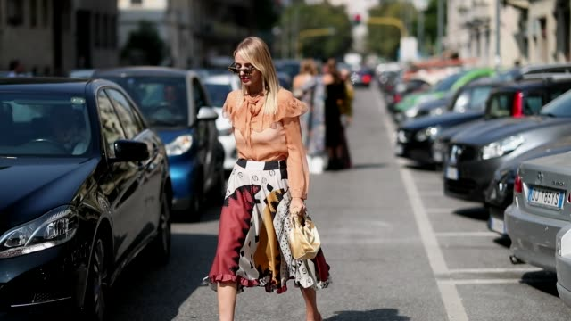 leonie hanne wearing orange blouse skirt with pattern is seen outside etro during milan fashion week spring/summer 2019 on september 21 2018 in milan... - bluse stock-videos und b-roll-filmmaterial